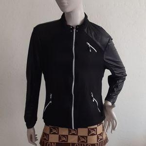 Jaime Saddock black jacket